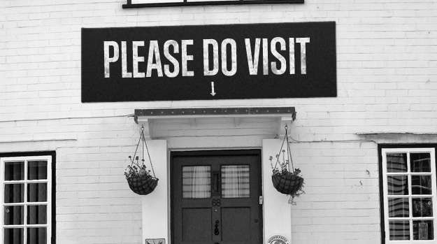 "Door with a sign saying ""Please do Visit"""