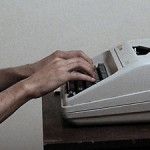 Hands on a typewriter