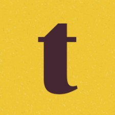 A fairly large t on a yellow background