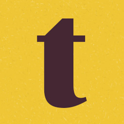 A large t on a yellow background